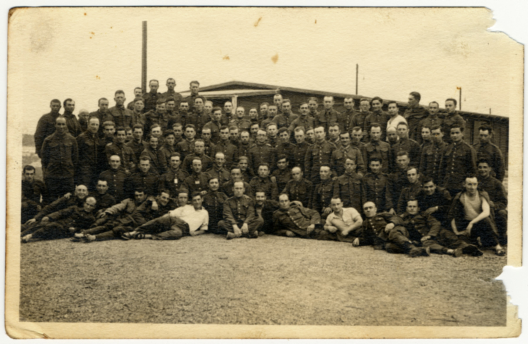 Group portrait of prisoners in the Elsterhorst prisoner of war camp, Stalag IV-A.