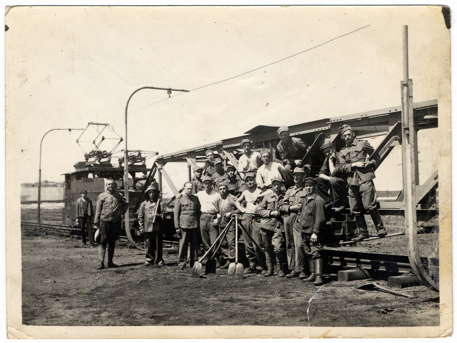 Prisoners in the Elsterhorst POW camp perform forced labor building or repairing train tracks.