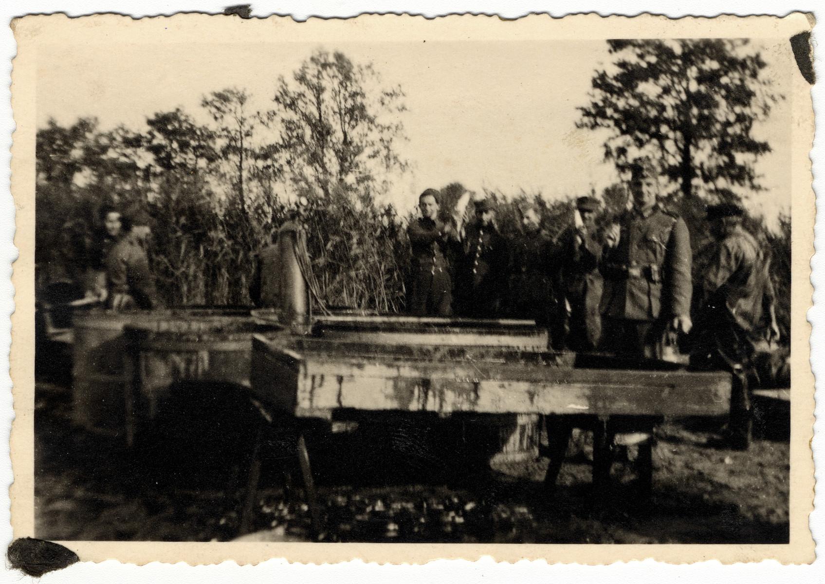 Prisoners in the Elsterhorst prisoner of war camp, Stalag IVa, perform forced labor.