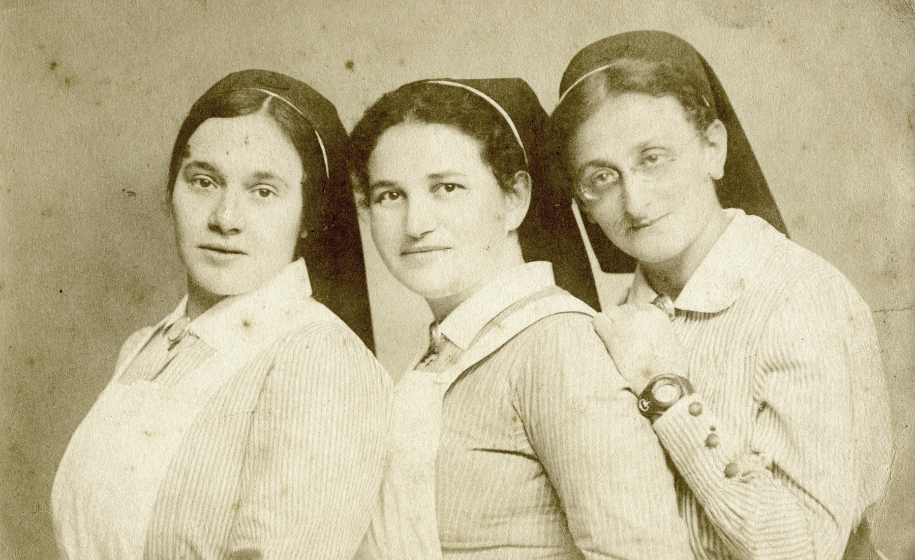 Studio portrait of three female staff members of the Beith Ahawah Children's Home.  The director, Beate Berger, is in the center.