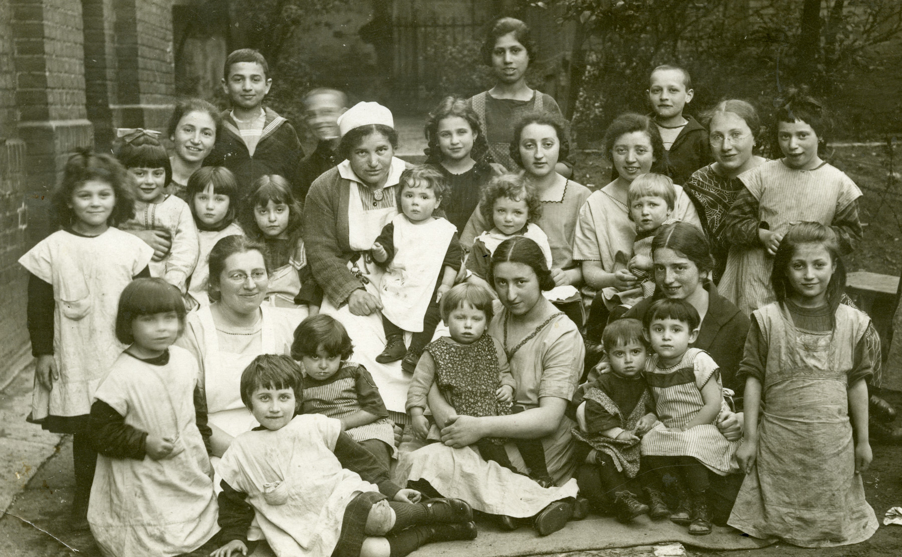 Children in the courtyard at Ahawah Children's Home. Seated center is Beate Berger, Director of the home.