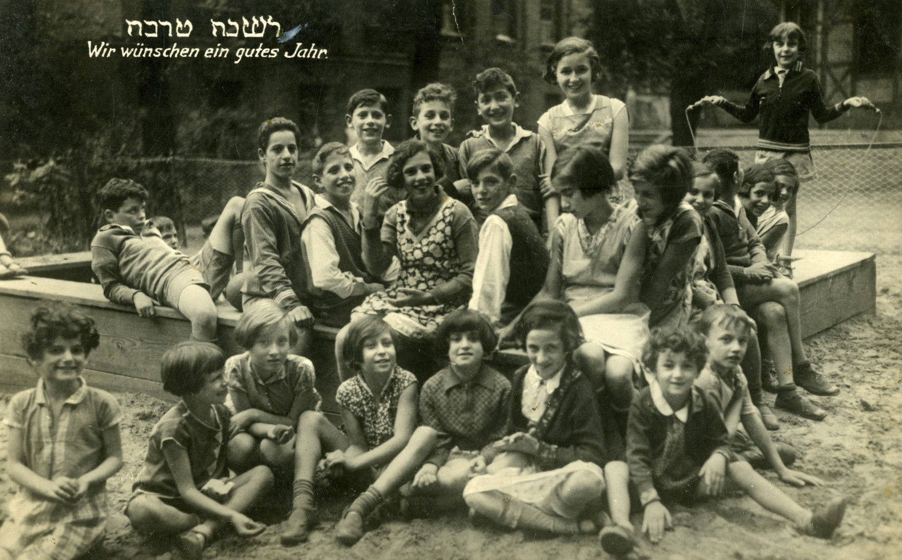New Year's Photo of the Ahawah children, who were the first group from the children's home to emigrate to Palestine.  Moritz, Moppel, and Grauden are in the middle row, left side. Eva Grunspan is in the middle row, first from the right. Paula Adler is in the upper row, right side. Hermann Glass is in the upper row, fourth from right. Hermann Zvi Marcus is in the middle row, third from right. Fanny Bergbaum is in the lower row, fifth from left. Ruth Kirschenzweig is on Fanny's right.