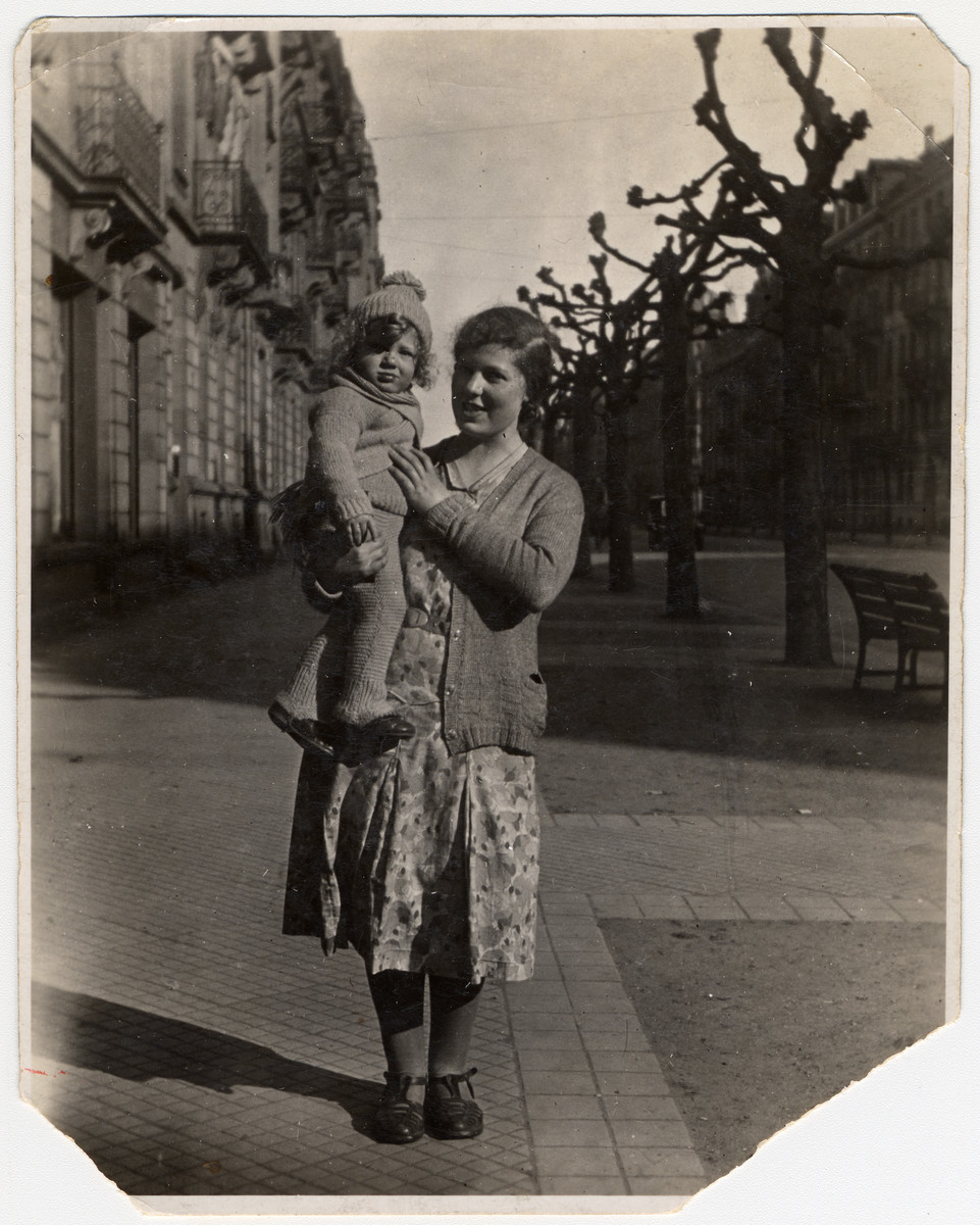 Fanny Klein holds her baby brother Jacques in her arms.