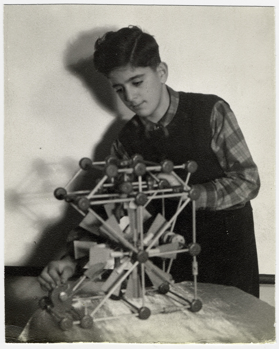 A student builds a simple machine at the Mediterranean School in Recco, Italy.
