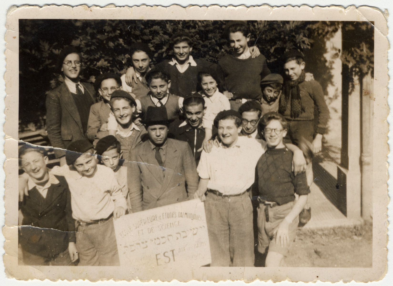Group portrait of students in the Yeshiva Chochmei Tzorfat (scholars of France) in Aix-les-Bains.  Rabbi Chaikin is pictured in the center.  To his immediate right is Jacques (Jacko) Klein.