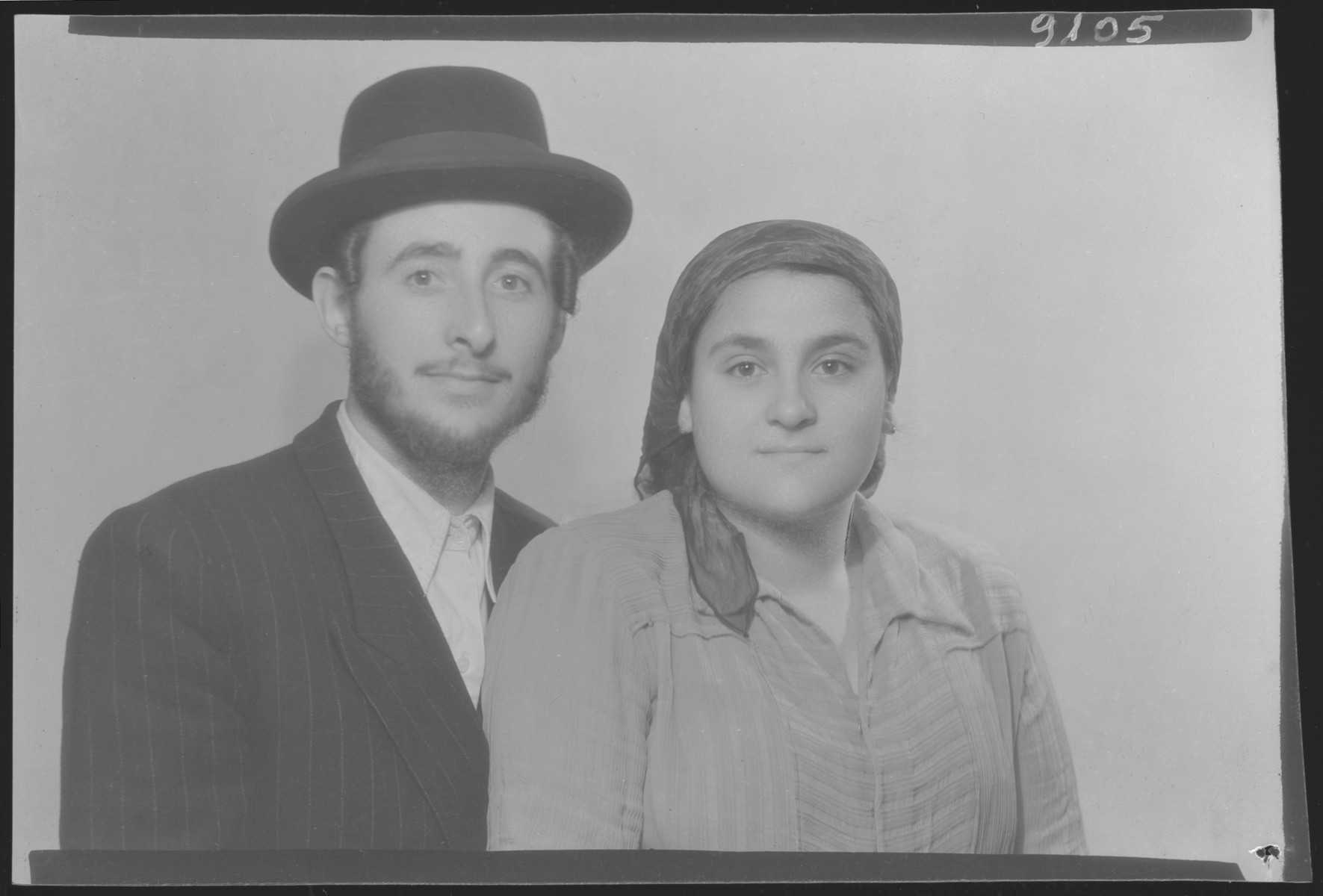 Studio portrait of Chaim Adler and his wife.