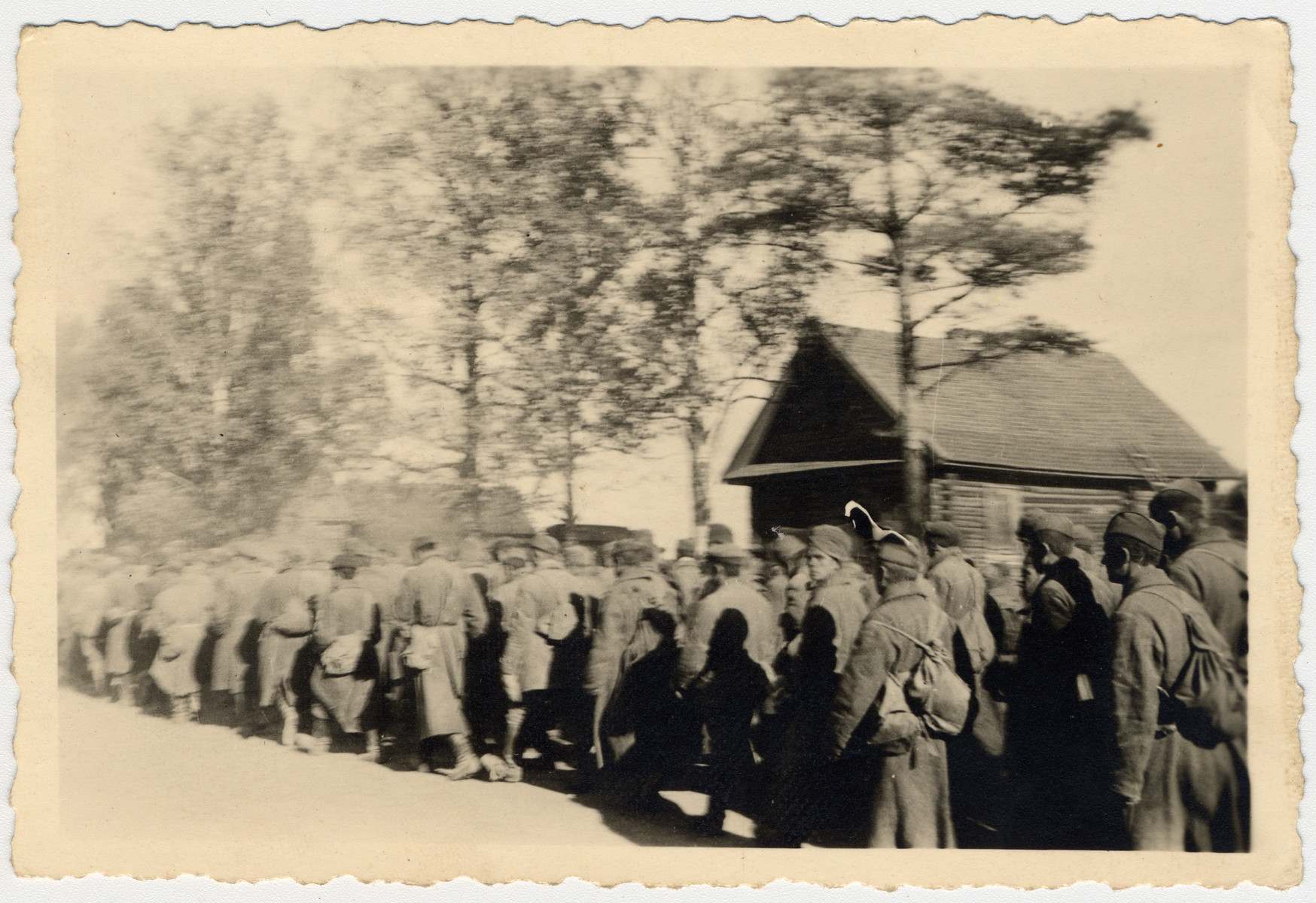 "The caption in German says, ""Transport of 2,100 prisoners.""  They are most likely Soviet POWs."