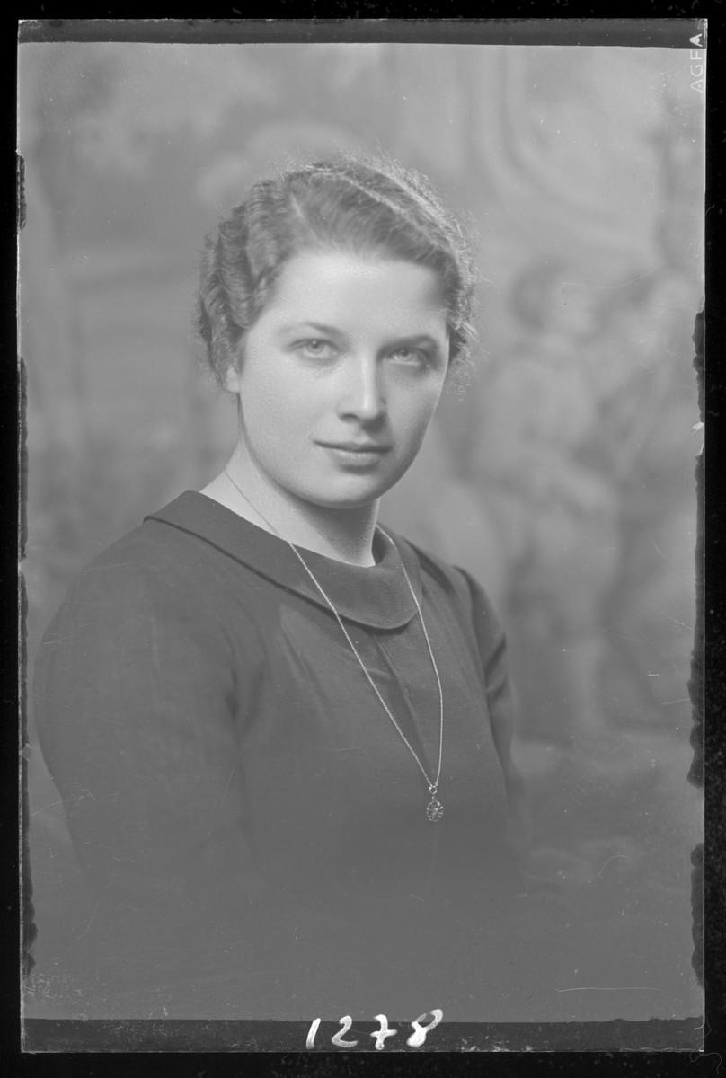 Studio portrait of Margit Berger.