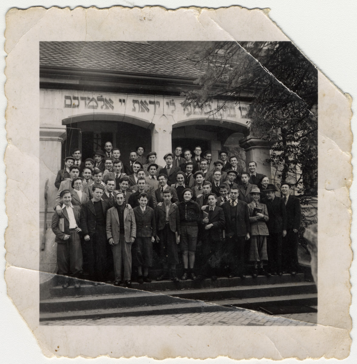 Students pose for a group shot outside the yeshiva in Montreux, Switzerland headed by Rabbi Botchko.  Jacques Klein is sixth from the left.