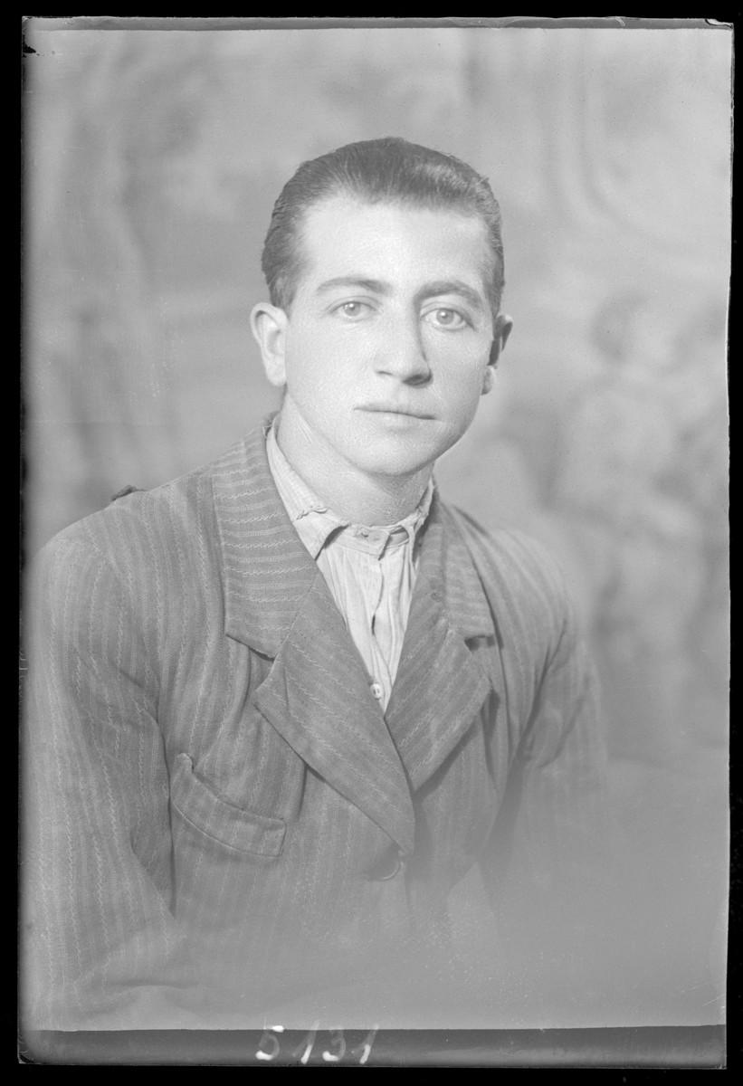 Studio portrait of Simon Abraham.