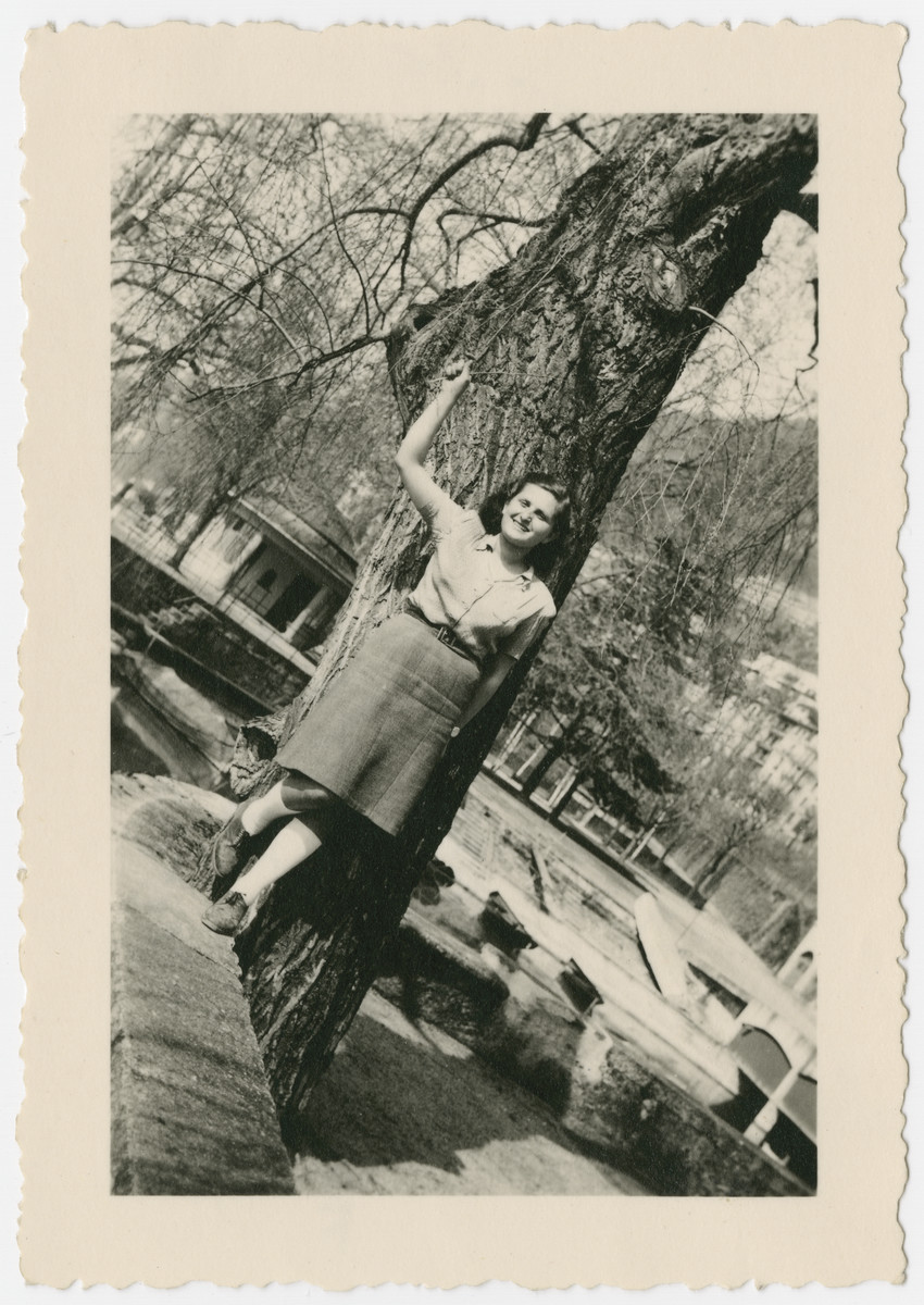 Eva Weinberger stands underneath a tree in Caux, Switzerland after arriving on the Kasztner transport.
