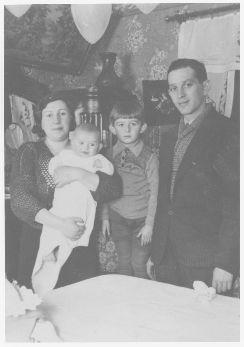 The Nussbaum family poses in their home in Sandomierz.  From left to right are Regina holding Shlomo, Aaron and Abraham Nussbaum.