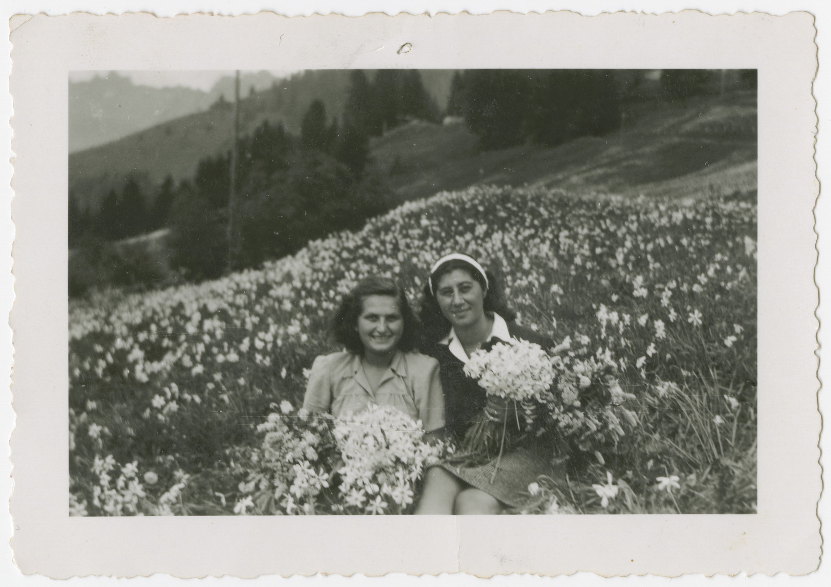 Eva Weinberger (left) and a friend pose in a field of wild flowers in Castella di Trevano.