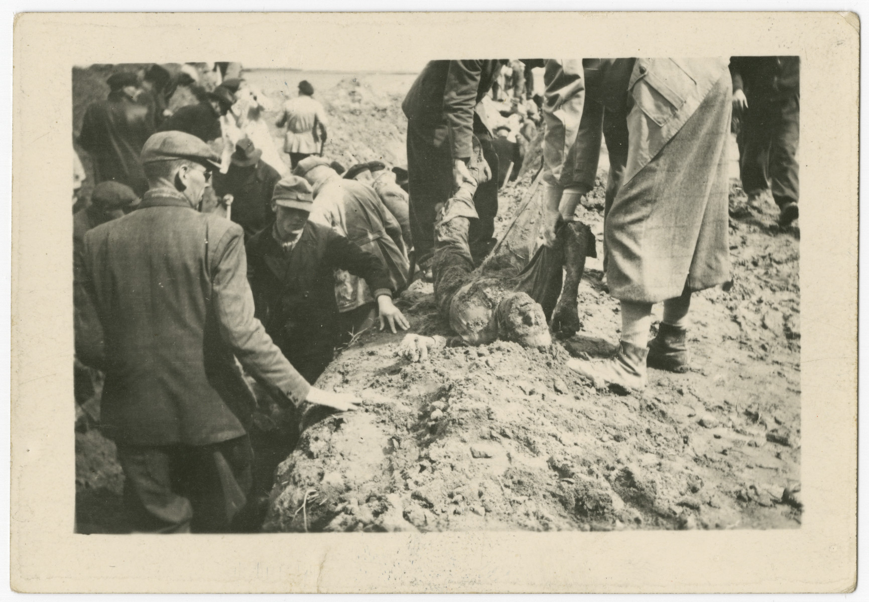German civilians dig graves for the victims of the Gardelegen atrocity.