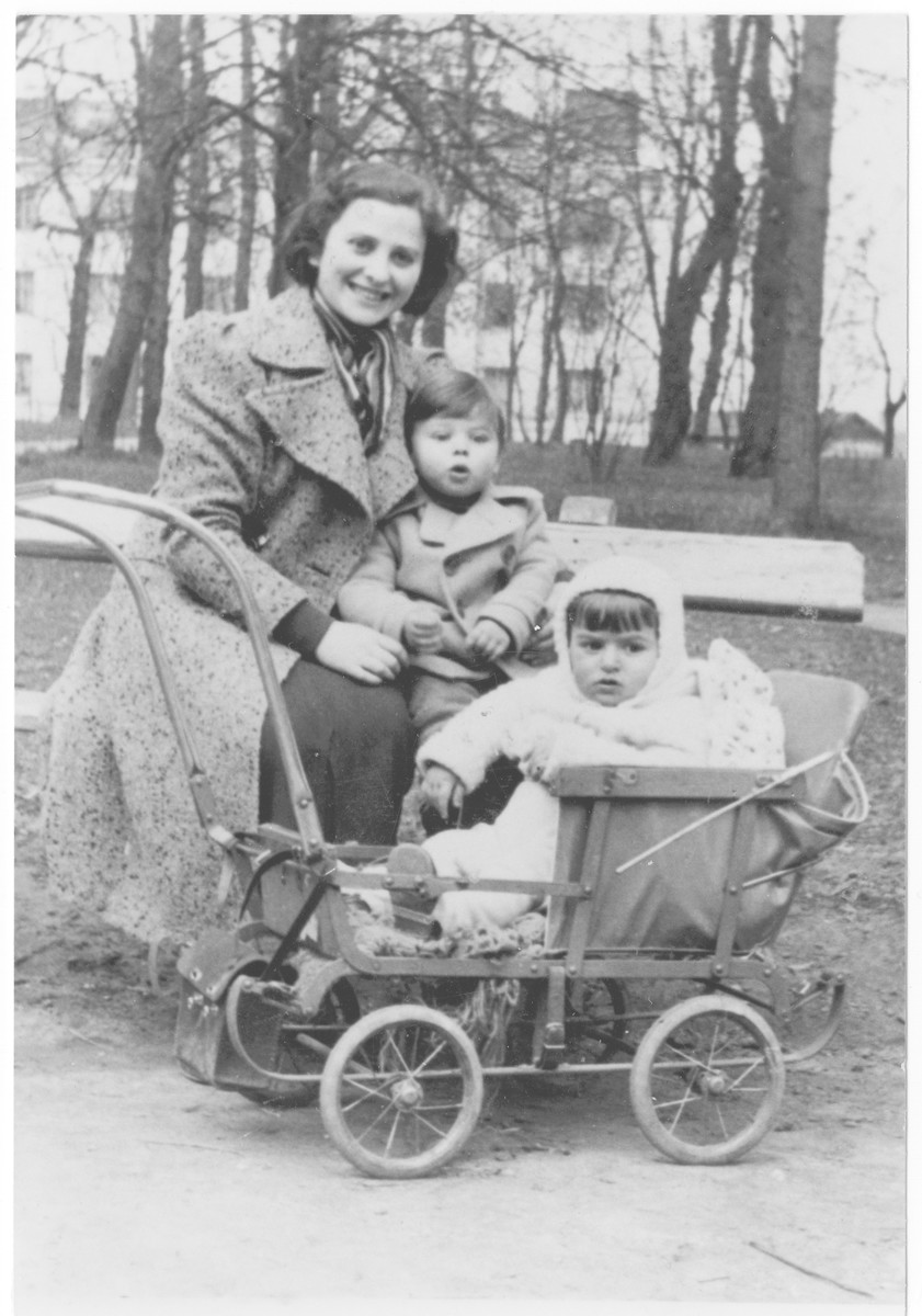 Members of the Nussbaum family pose in a park in Sandomierz.  Pictured are Chana Nussbaum (donor's aunt), her son Zvi and her nephew Shlomo Baruch (Mark, the donor).