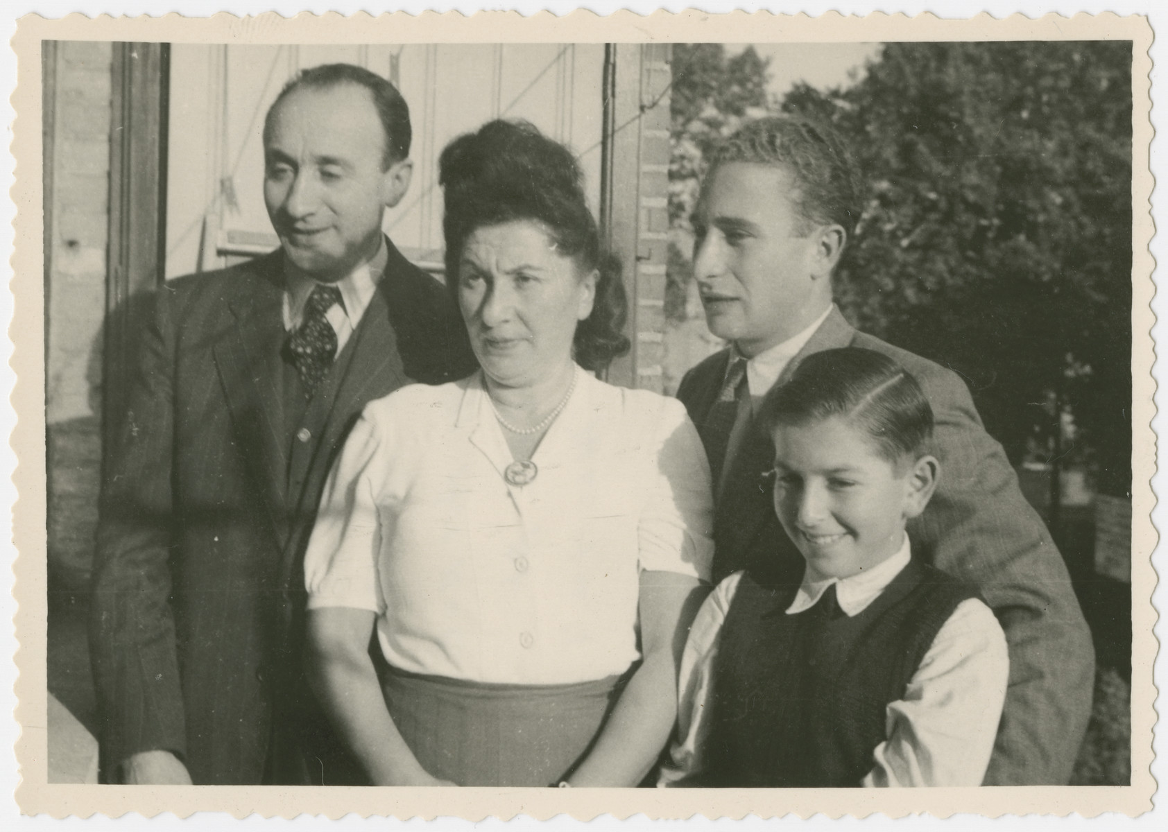 Portrait of the Elbaum/Nusbaum family in their home in Brussels.  From left to right are Chiel Elbaum (the donor's step-father), Regina Nusbaum Elbaum (the donor's mother), Chaim Elbaum (the donor's step-brother) and Mark Nusbaum.