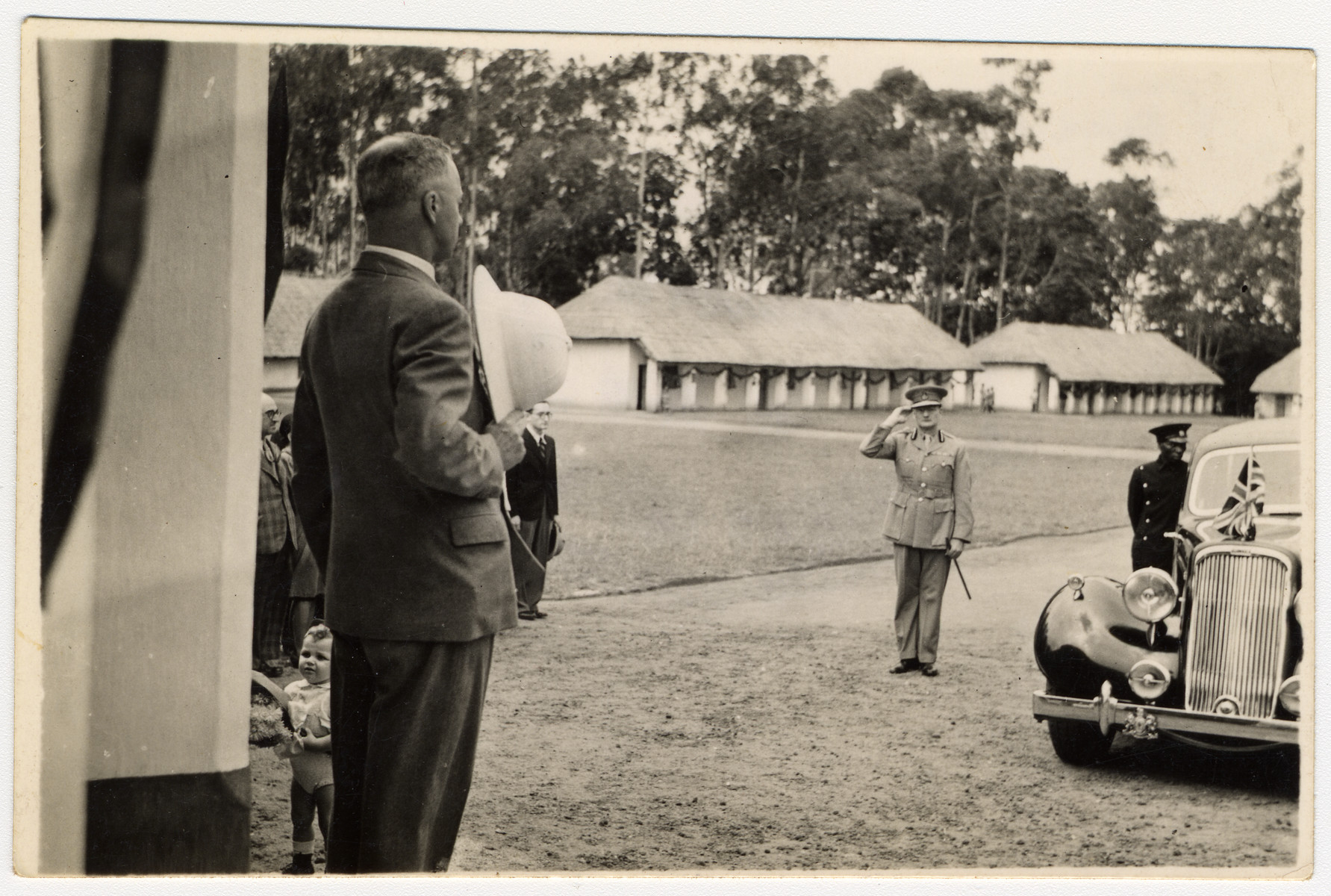 A British official inspects an internment camp for enemy aliens in Nyasaland.
