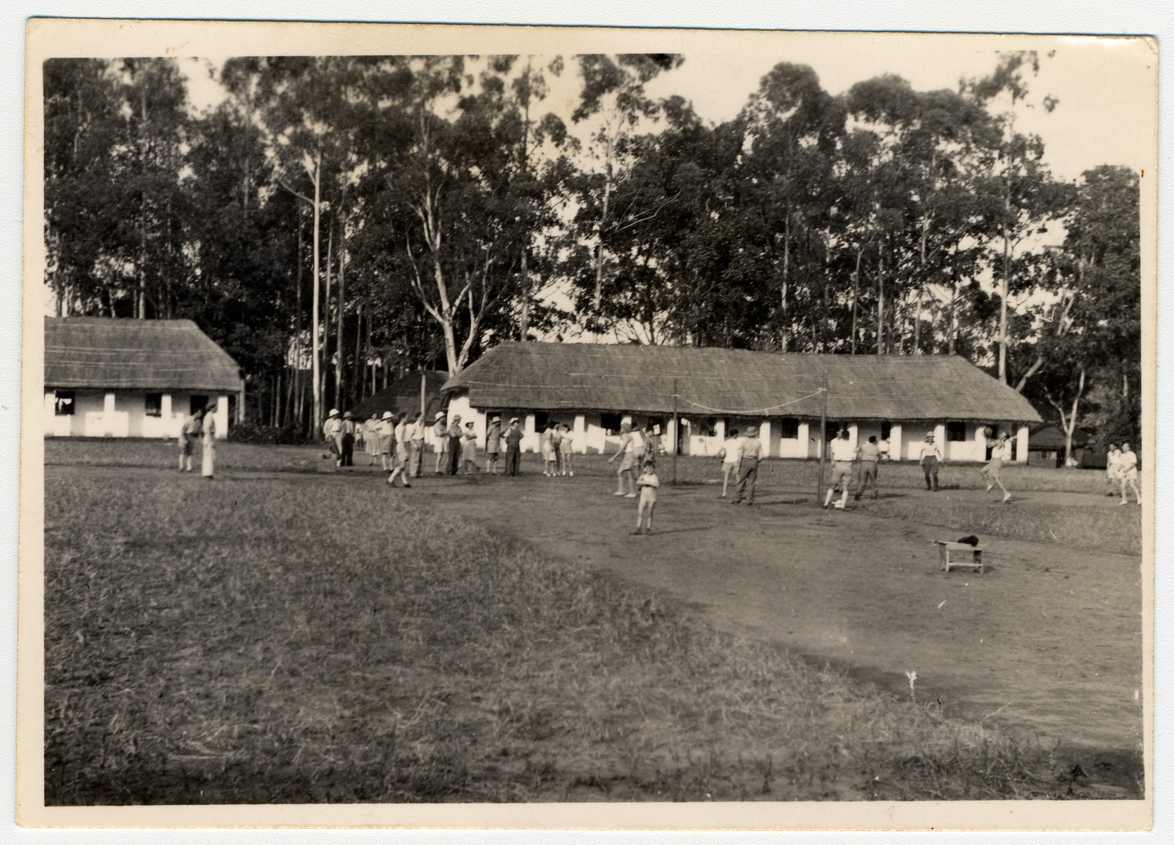 Internees play a sport on a grassy field in the internment camp for enemy aliens in Nyasaland.
