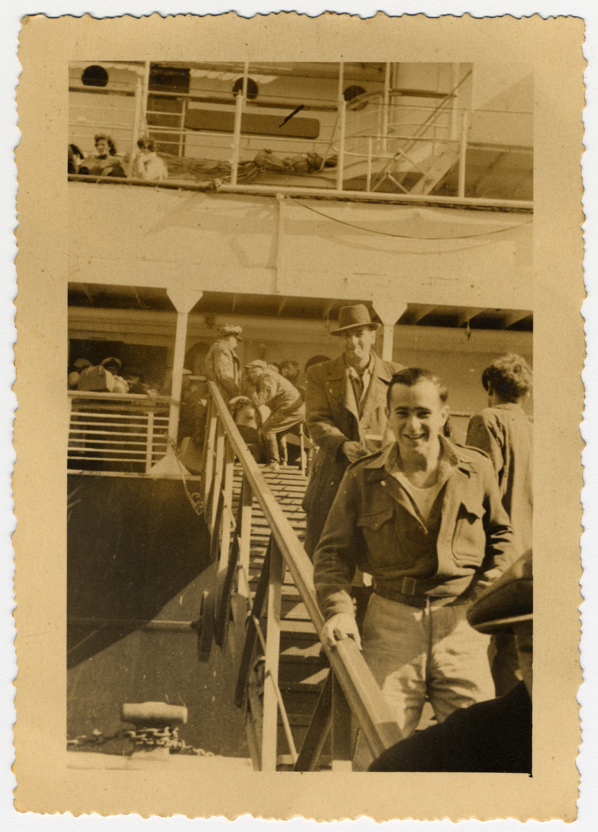 """William Weintraub (""""Sonny""""), the chief radio operator of the SS Galilia walks of the gang plank in Haifa.  The Galila sailed from Constanta Romania to Israel."""