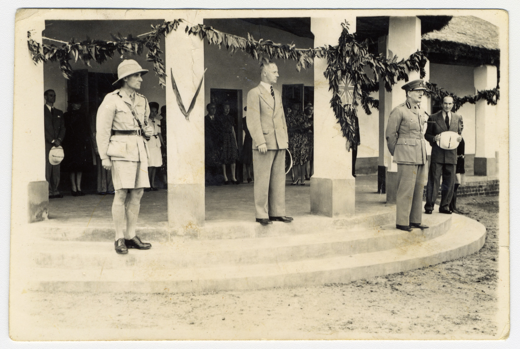 British officials pay a formal visit to the internment camp in Nyasaland for enemy aliens.  Standing in the back between the two columns are Kalman and Lily Haber.