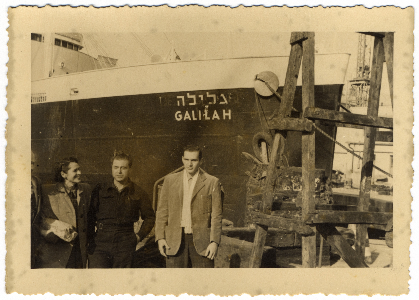 "Zev Siegel, the second mate ""Taffy"" and an unidentified woman pose in front of the dry-docked Galilah."