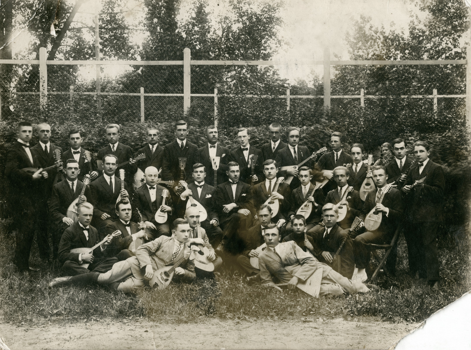 A photo of an all men's mandolin orchestra.  Feivel Frankfowicz is pictured in the middle row, third person from the right.