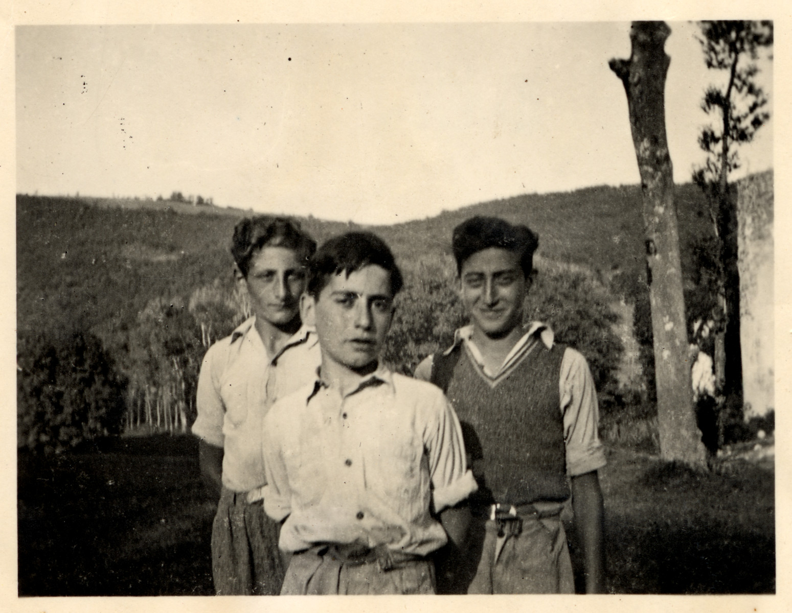 Three young men pose for a photograph at the children's home of Chateau de la Hille, two years prior to joining the resistence  Pictured left: Rudi Oehlbaum, Egon Berlin and Joseph Dortort. All three joined the French Maquis resistance fighters in 1944 at age 16 and fought in a battle at Roquefixade in July 1944. Egon and 16 young French fighters were killed in this battle. Oehlbaum and Dortort survived the war.