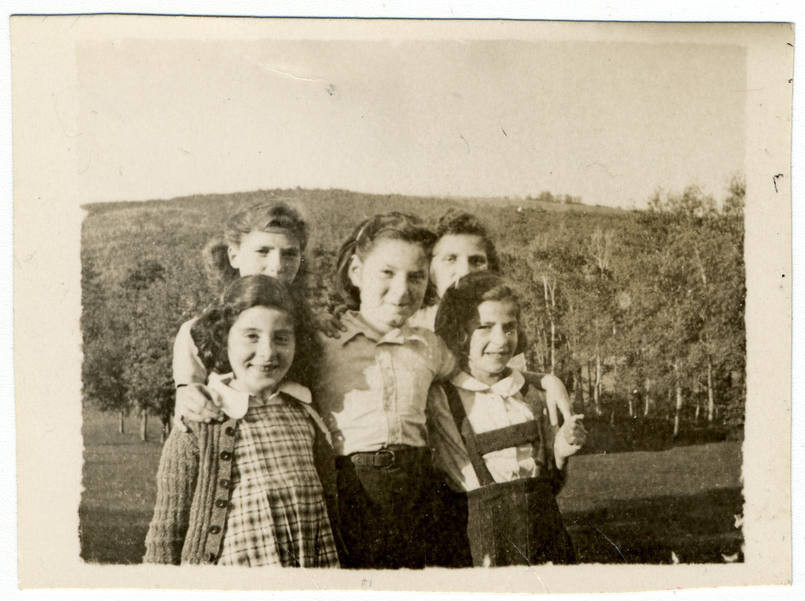 A group of young girls pose at the children's home of Chateau de la Hille.  Those pictured include Betty Schuetz (center) and Toni Rosenblatt (right front).