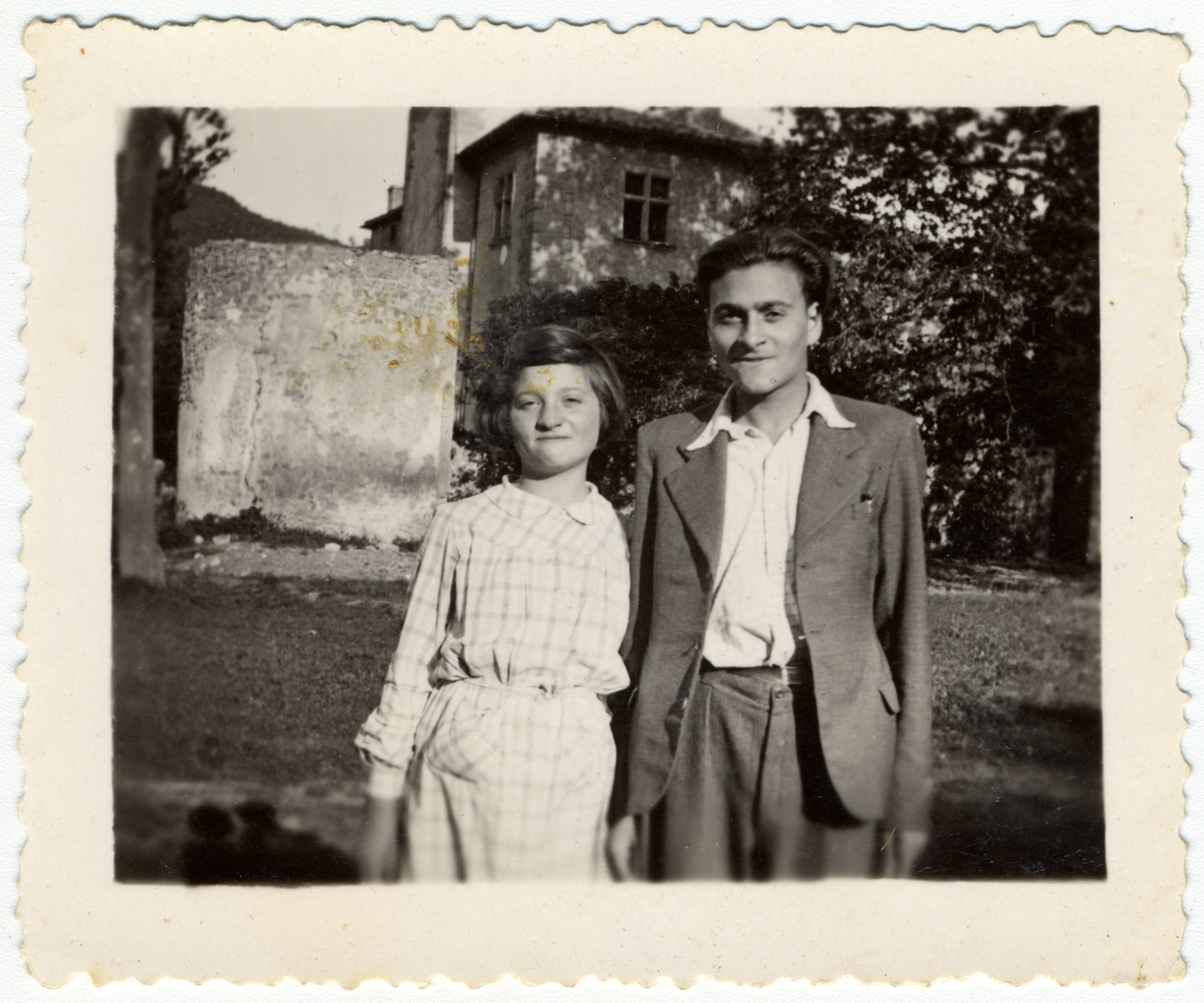 Two siblings stand in front of the children's home of Chateau de la Hille.  Pictured are Martha and Heinz Storosum.