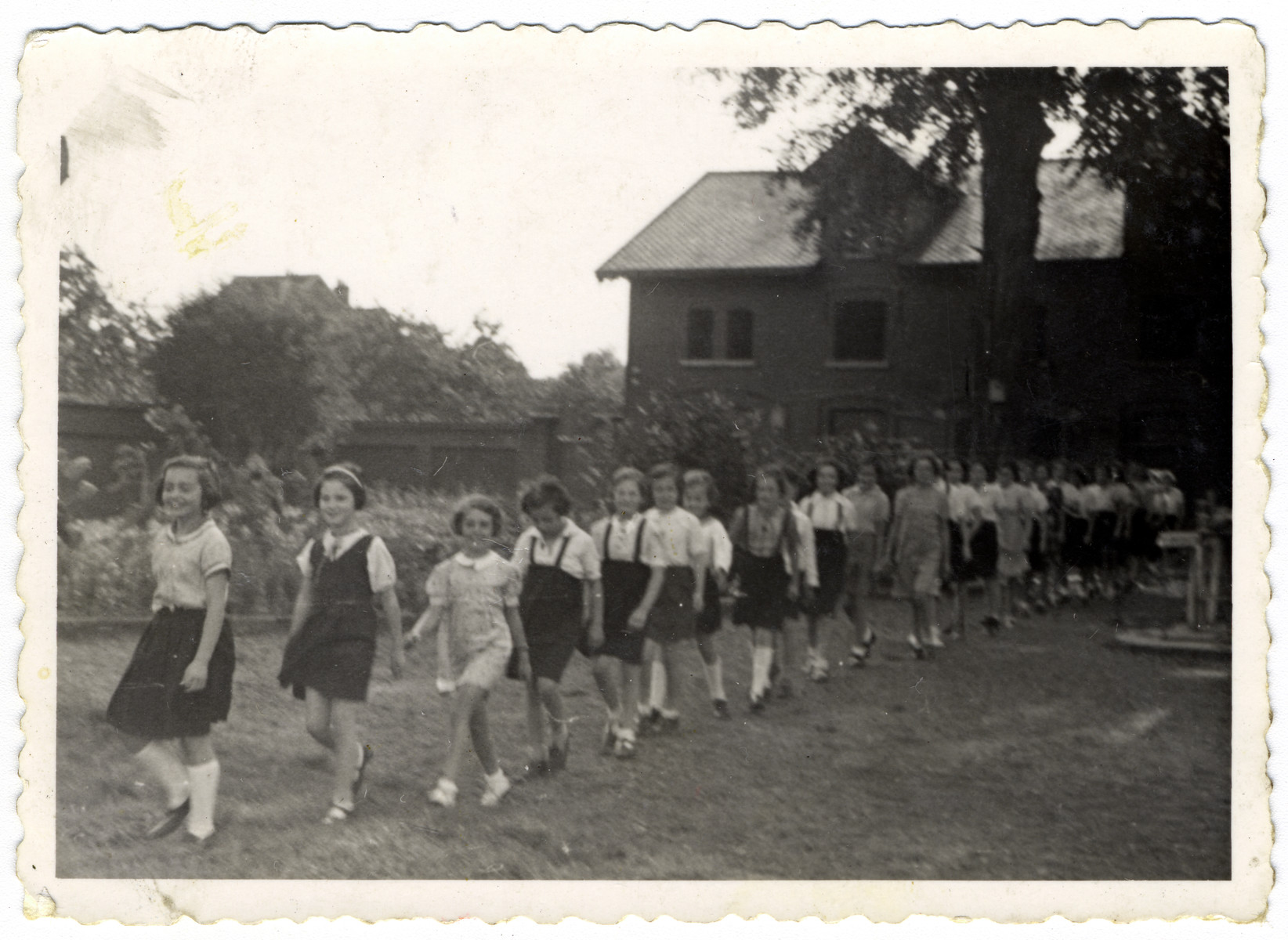 Young boys and girls walk in a line at the Home General Bernheim in Zuen, Belgium, a suburb of Brussels.