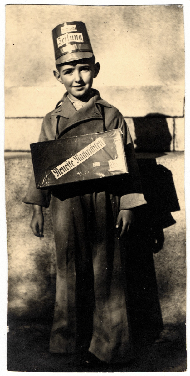 Franz Leiberman dressed in a costume distributes programs at the wedding of his aunt and uncle Heinz and Marianne Orgler.