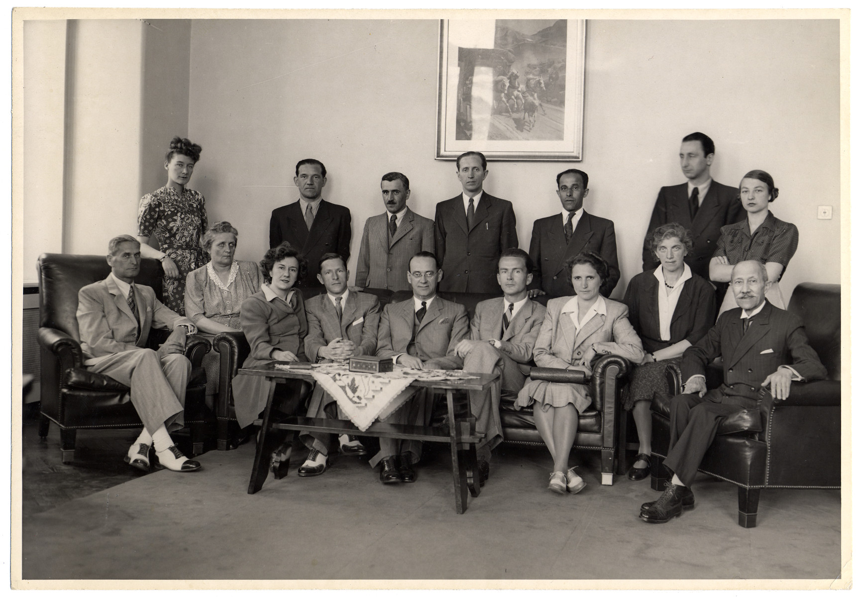 Group portrait of the Swiss consulate staff in Budapest.  Seated in the center is the Consul General, Carl Lutz.  Standing behind Mr.Lutz is his chauffeur Charles Szluha. Seated on the left is Mr. Steiner.