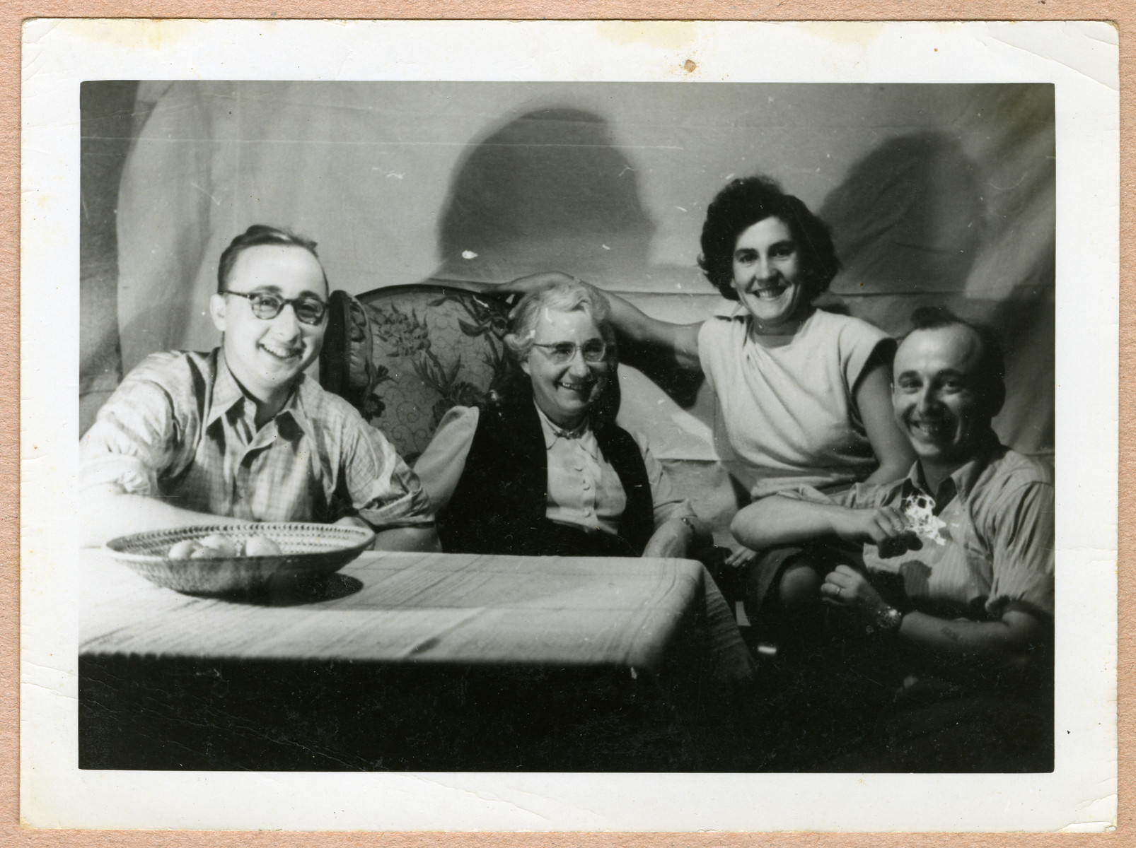 The Feigenbaum family relaxes in their home in Belgium the evening before Margot and Kurt left for the United States.  From left to right are Werner, Clara, Margot, and Kurt Feigenbaum.