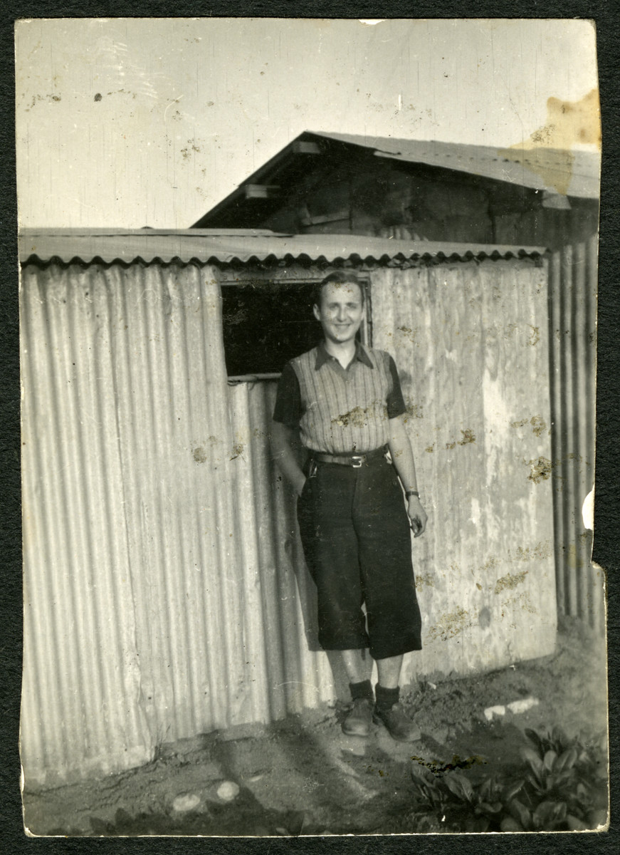 Kurt Feigenbaum stands next to a barrack in the Saint Cyprien camp after his deportation from Belgium.