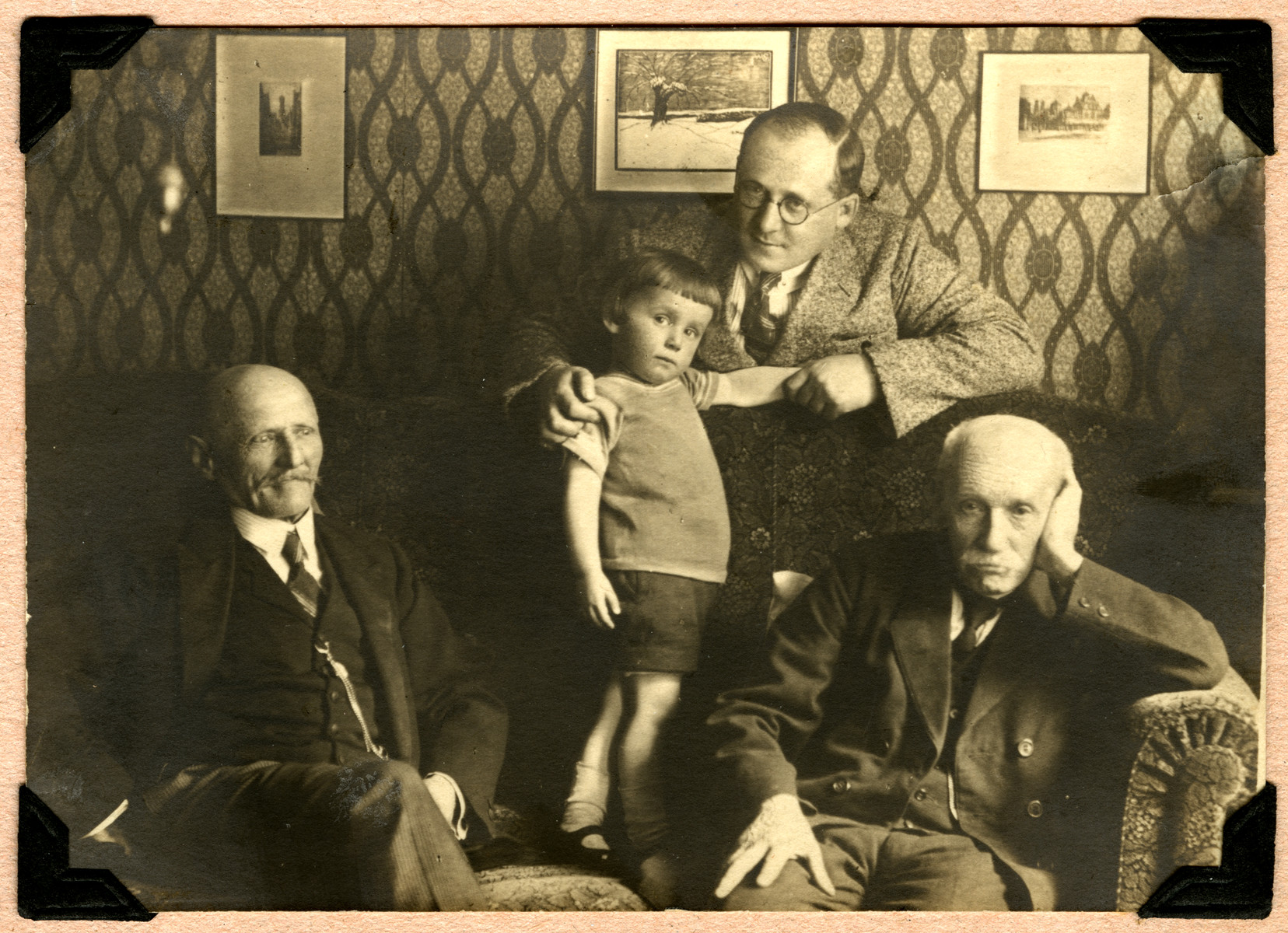 Portrait of four generations of the Feigenbaum family in their home.  From left to right are Mortiz, Kurt, Emil and Emanuel Feigenbaum.