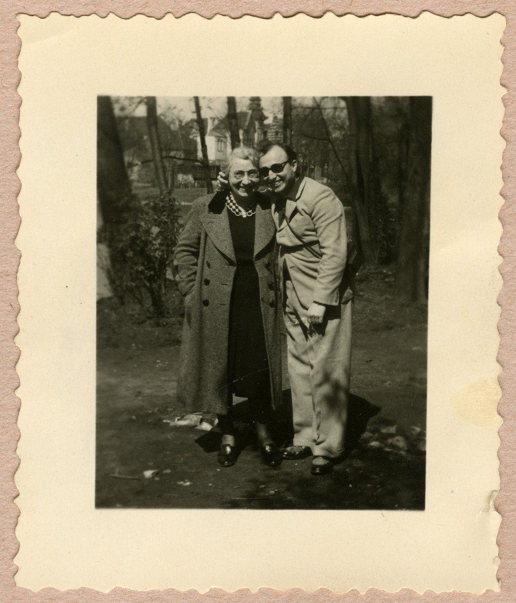Kurt Feigenbaum poses with his mother Clara in a garden after liberation.