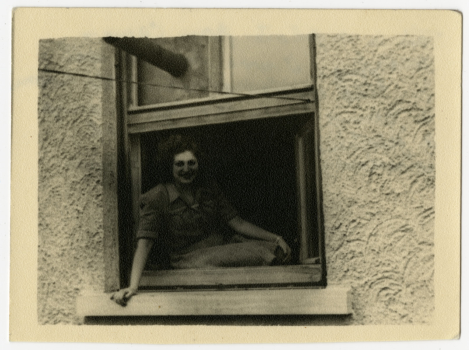 Gizelle Herskovits sits by the window of her barrack at the Feldafing displaced persons camp.