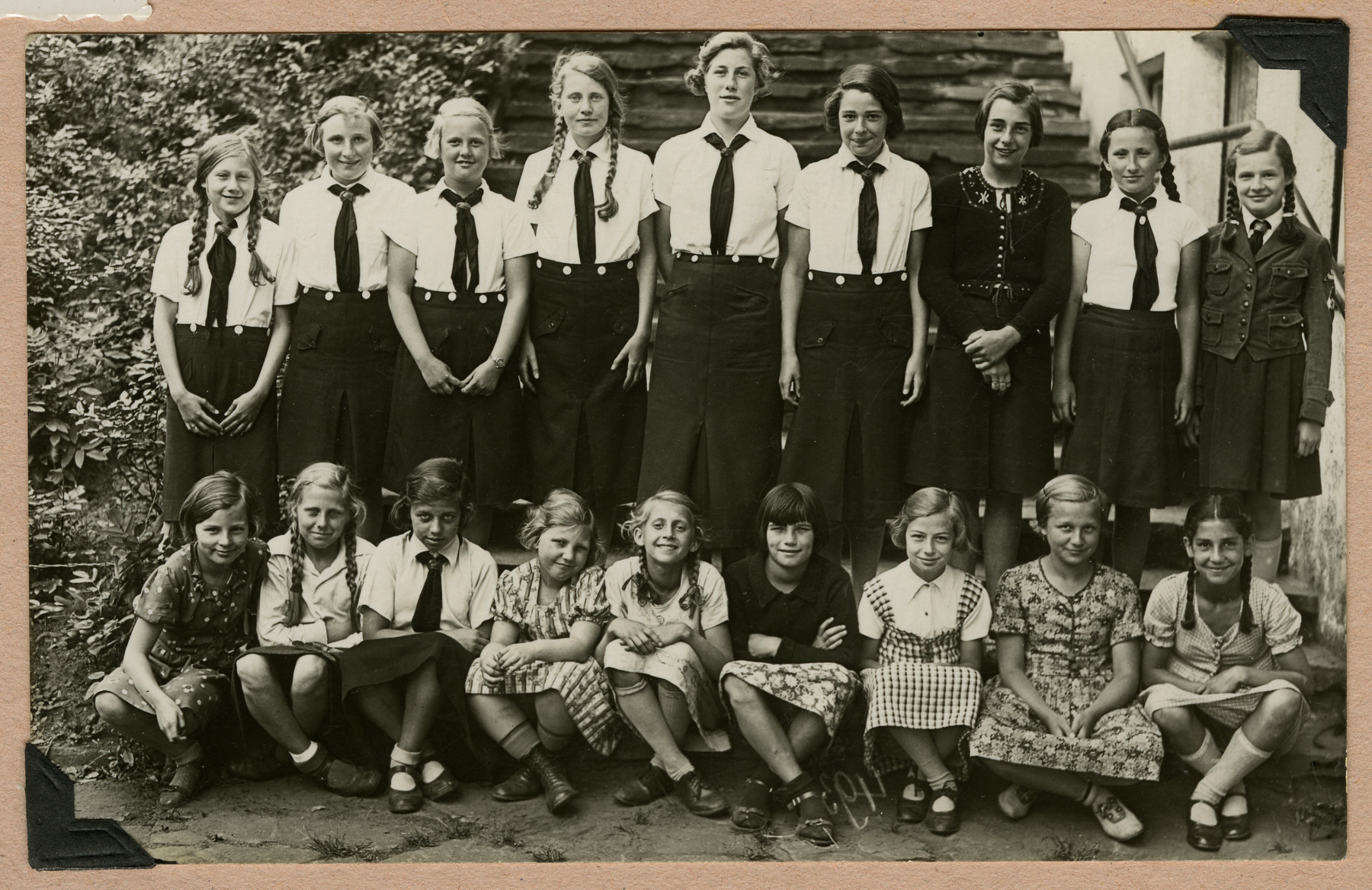 Group portrait of German school girls in Nazi Germany.  Magot Alt is seated on the far right.  (She was not permitted to wear the school uniform for the picture because she had misbehaved.)