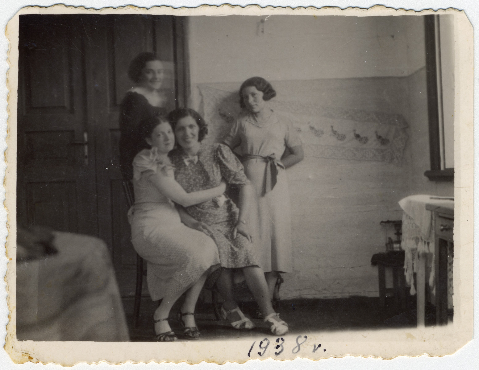 Portrait of four women in a home in Zetel.  Shanke Minuskin is pictured in the center with three friends.