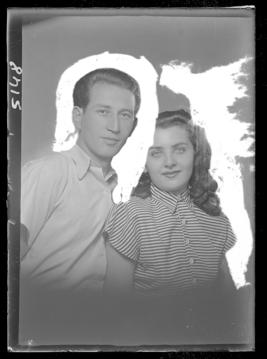 Studio portrait of Lazer Cavarovitz and his [wife or girlfriend].