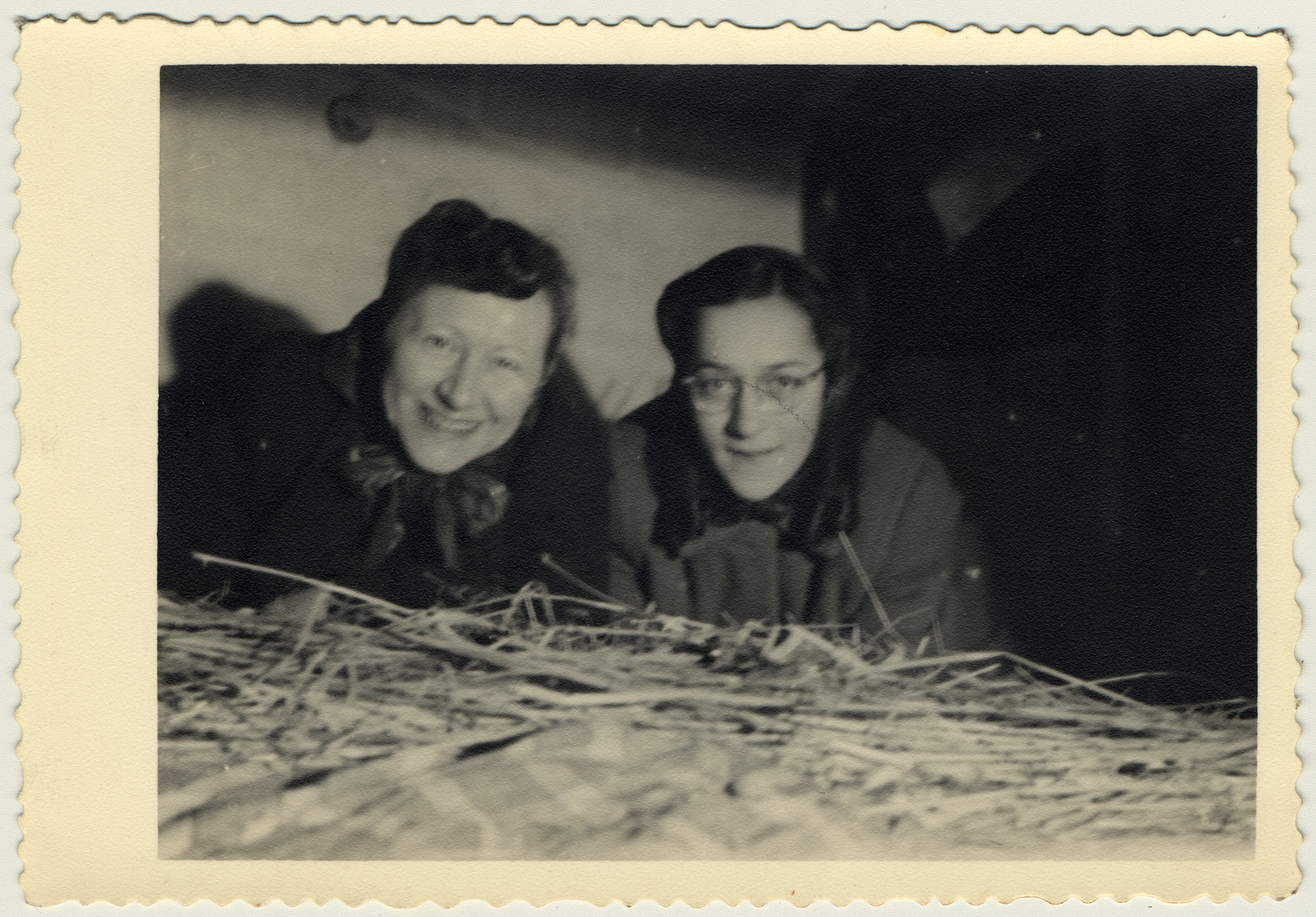 Suse and Kate Grunbaum lie in an attic storeroom at the home of Bernard and Mina Hartemink in Sinderen, the Netherlands, where she was hidden during the war.