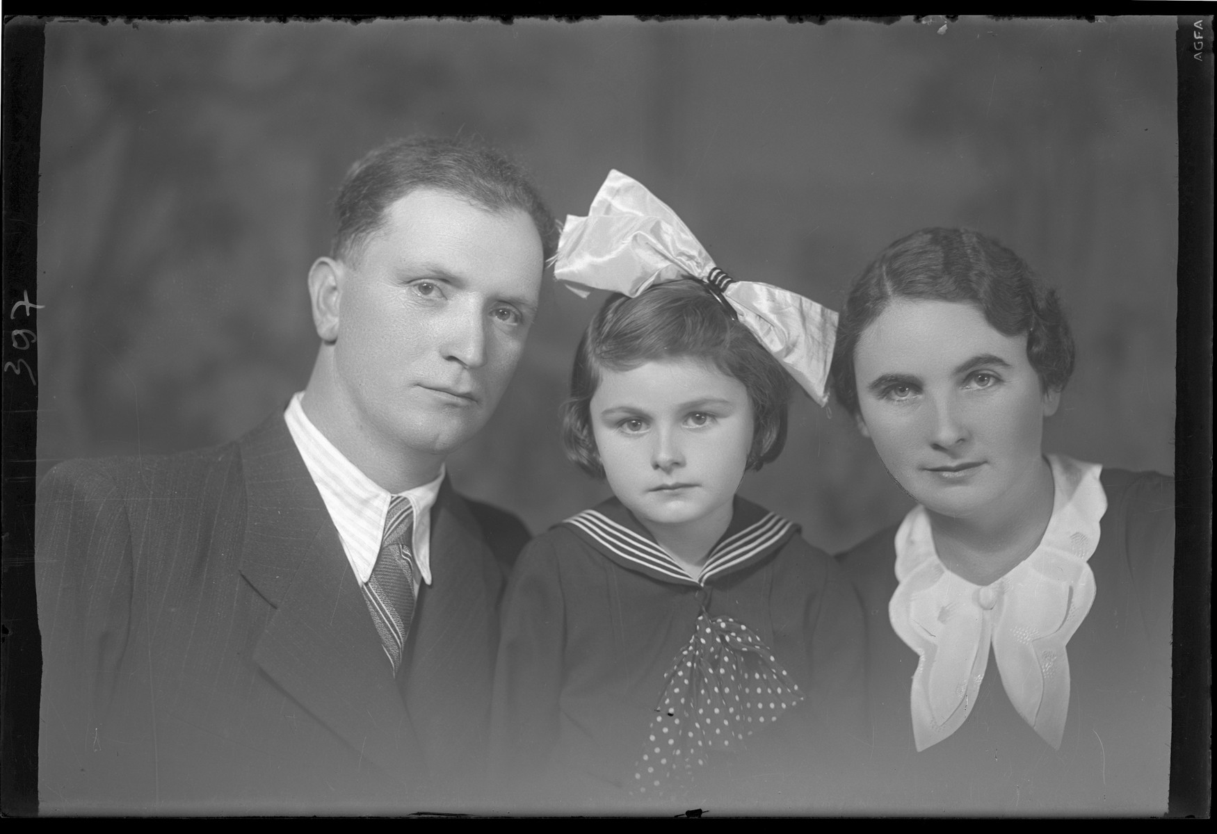 Studio portrait of Csaled Berkovits and his family.