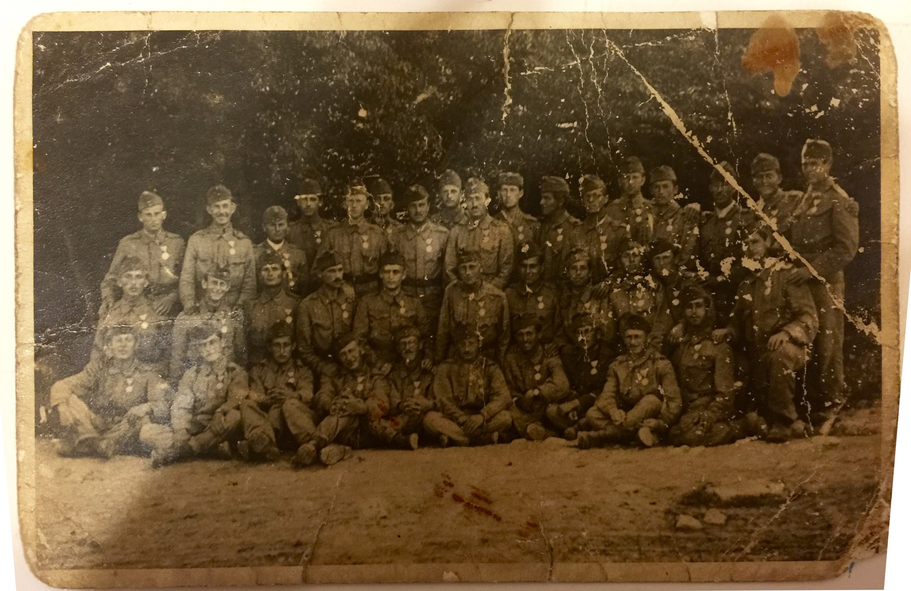 Group portrait of Hungarian soldiers, both Jewish and non-Jewish.  Israel Fried is seated on the ground, first on the right.  He served as a sharp shooter.