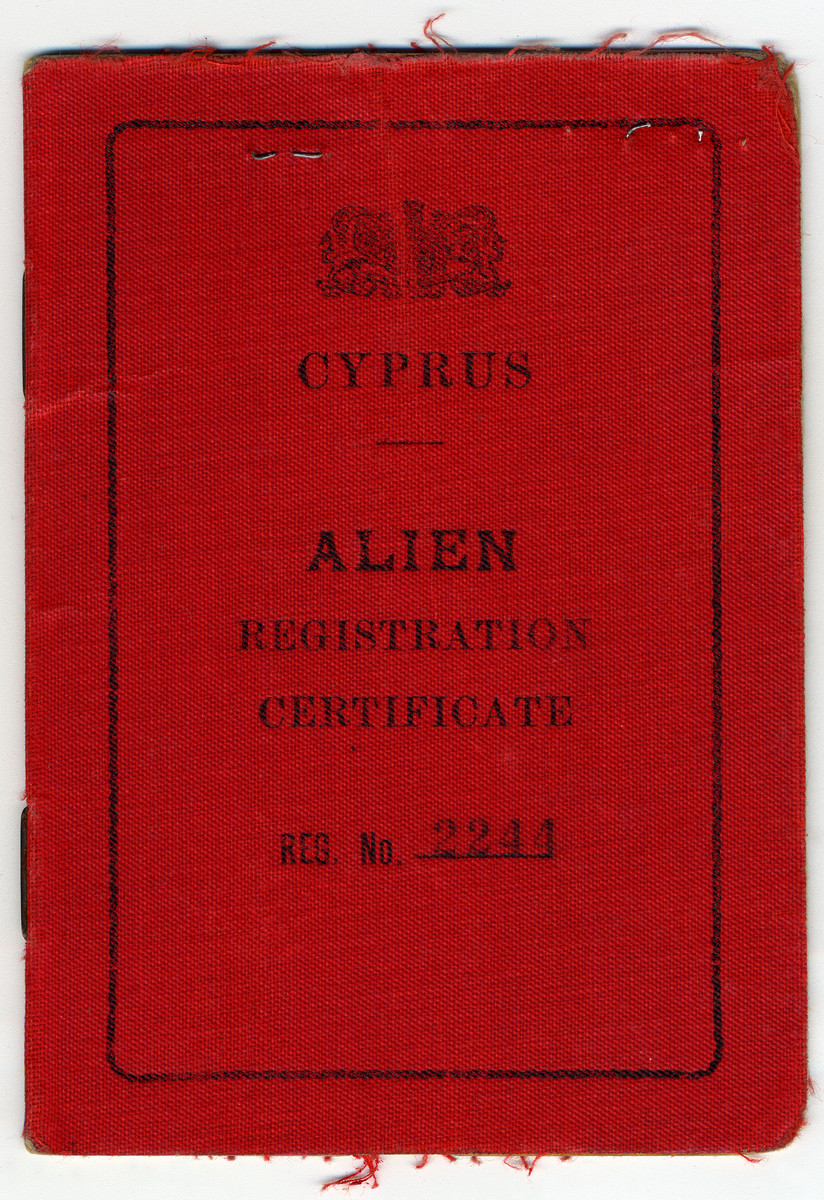 A bright red enemy alien registration identity card issued in Cyprus to Kalman Haber, an Austrian Jewish refugee.