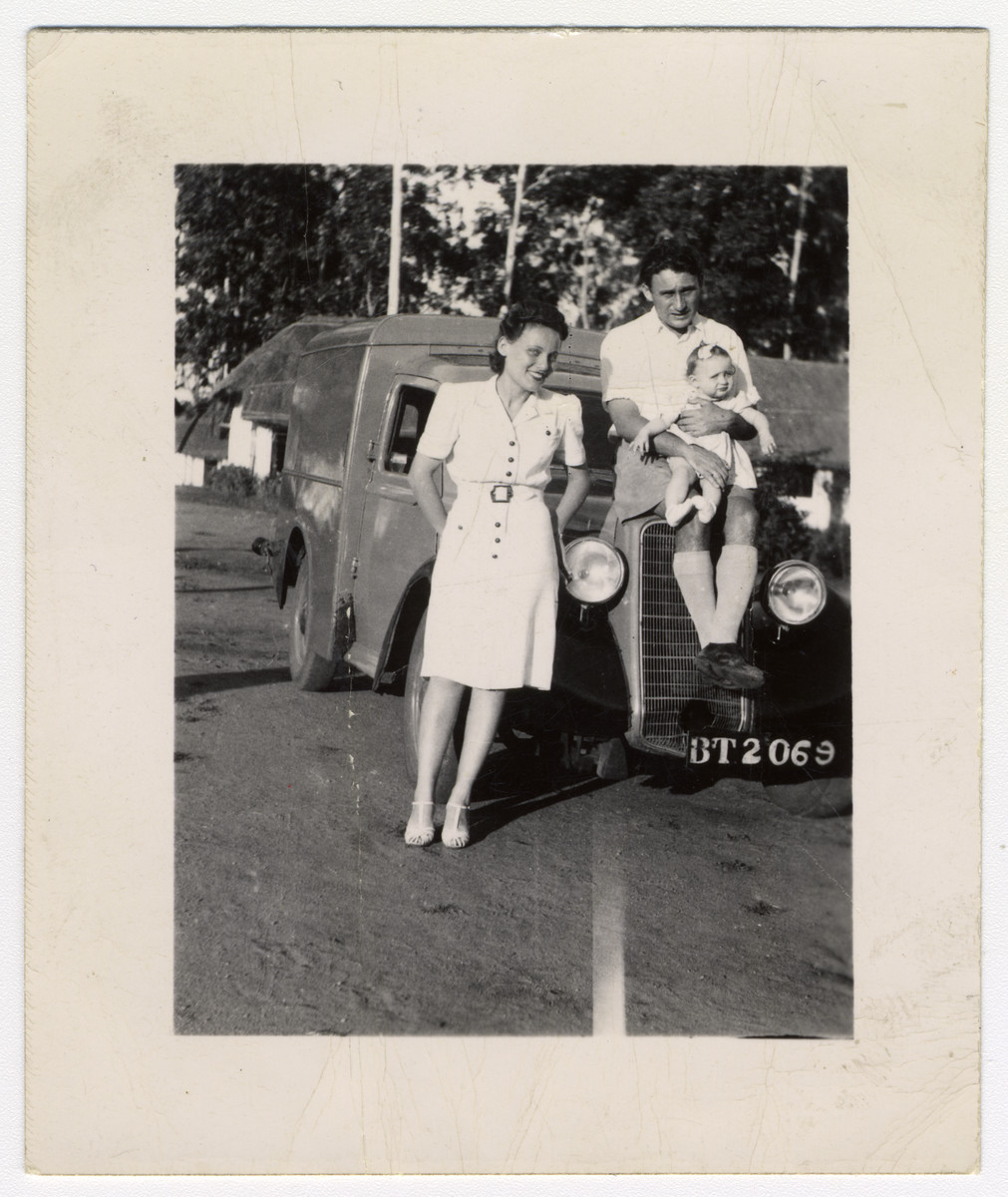 A Jewish refugee family poses next to their automobile in Zomba, Nyasaland.  Pictured are Lily, Kalman and Ruth Haber.