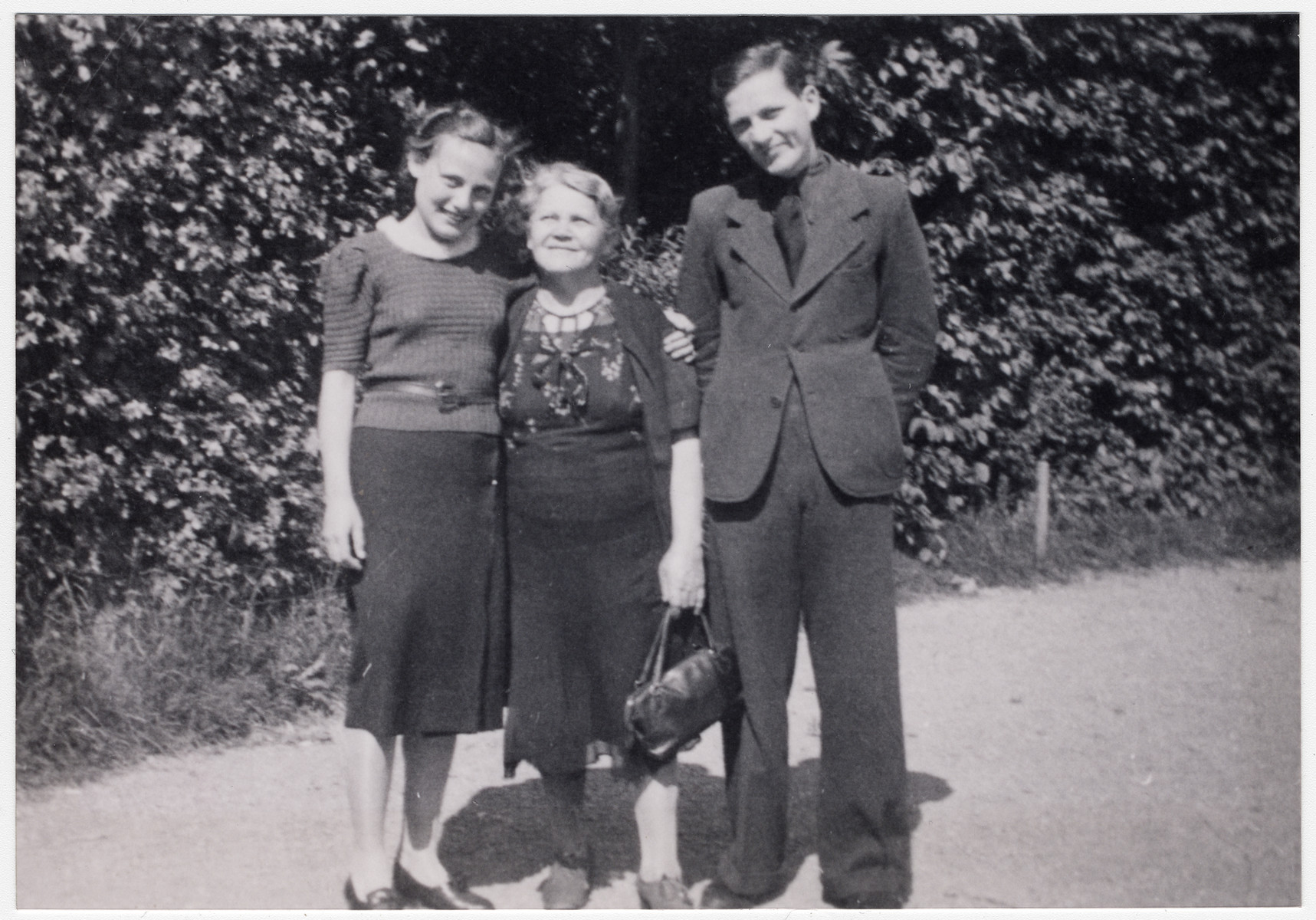 Close-up portrait of an Austrian Jewish mother with her son and daughter shortly before the Anschluss.  Pictured are Lily, Ernestine and Alfred Juffy.