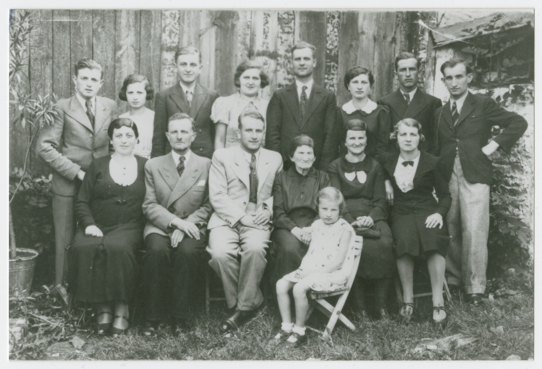 Prewar portrait of the extended Ring family in Krzepice, Poland.  Pictured left to right are front row: Sura Fajga Ring, Zeleg Ring, Russell Ring, Sura Ring, Brindel Ring and Deborah Ring.  The young girl in front is Mania Ring.  Back row: Henoch Ring, Henia Ring, Chemya Rosen, Srul Rosen, Liah Rosen, Etcho Rosen and Mendel Ring.