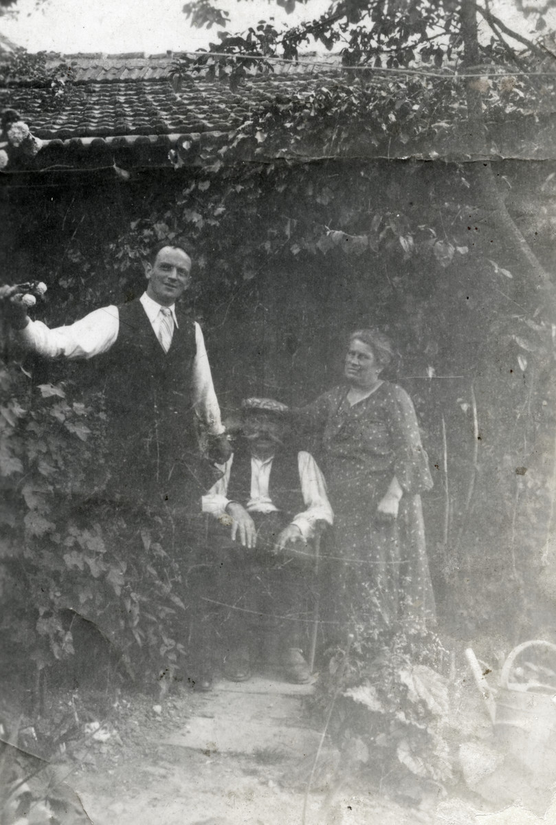 Jacques Michel's grandparents, Julian and Emile and his uncle Artur pose in a garden in wartime Giat.