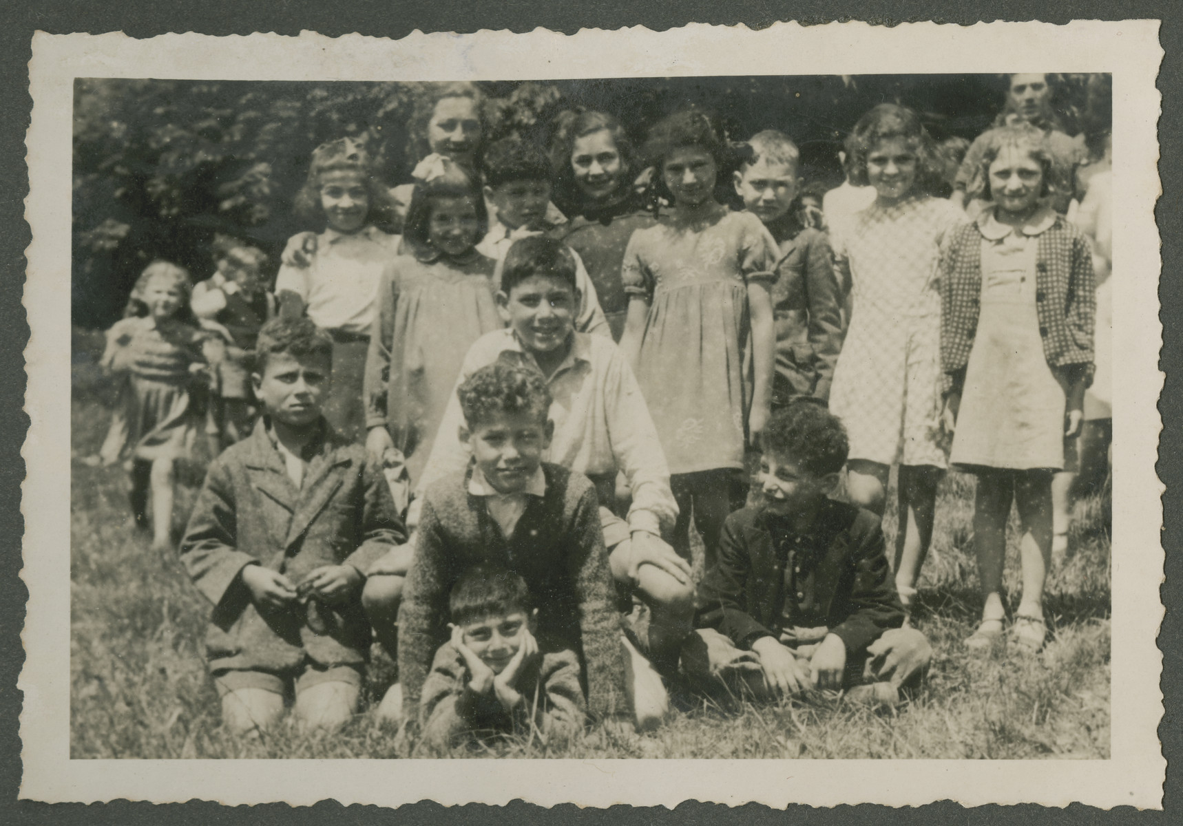 Group portrait of elementary age children in a Zionist children's home in Switzerland.