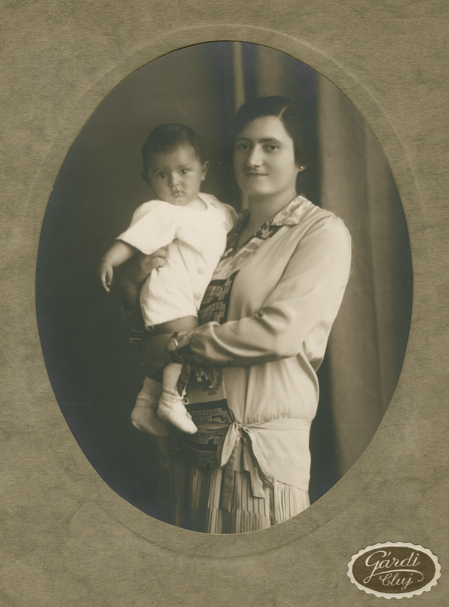 Studio portrait of Boriska Blatt holding her infant son Robert.